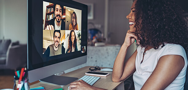 woman in a video conference with four remote participants